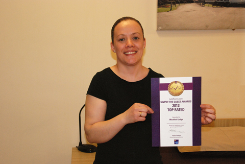 Christine Tynan with the Simply the Guest Award