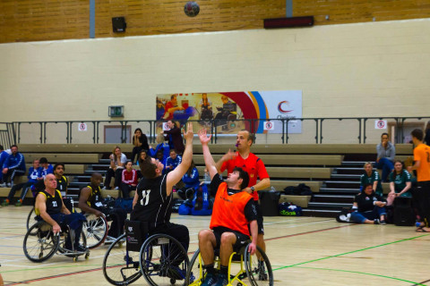 Wheelchair Handball players in action