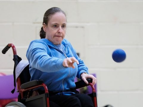 Woman playing boccia