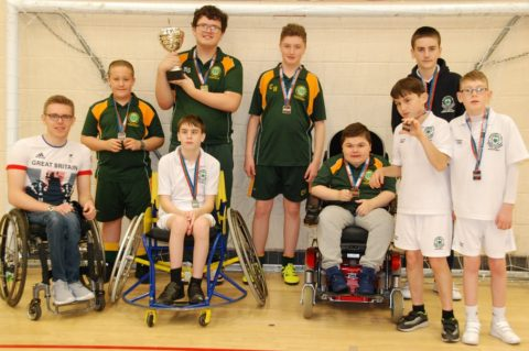 Pupils from Broadgreen and Woodchurch schools with medals and trophy