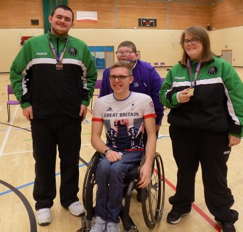 Paralympian Nathan Maguire presents medals to event finalists