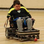 Young person going for the goal.